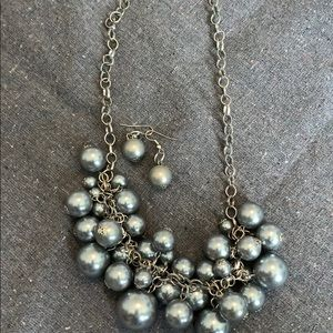 Gray beaded necklace with earrings
